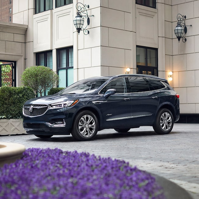 Exterior of the 2019 Enclave Avenir shown in Dark Slate Metallic.