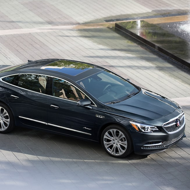 Buick LaCrosse Avenir in Dark Shadow Metallic with available 20-inch machined aluminum alloy wheels.