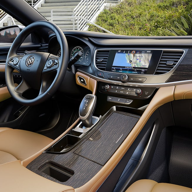 Interior of the LaCrosse Premium shown with Brandy perforated leather appointed seating and Ebony accents.