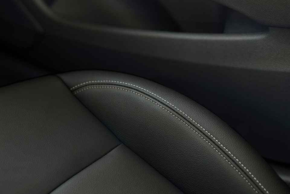 Interior of the Buick Regal Sportback with available leather-appointed seats and French contrast stitching.