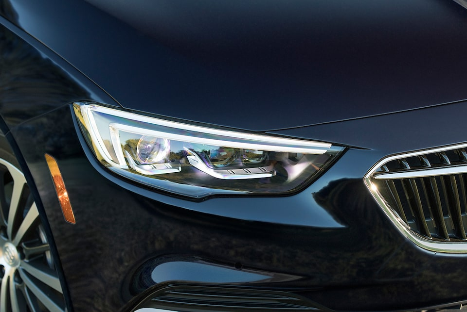 Buick Regal Sportback exterior: sculpted headlamps with LED signature lighting.