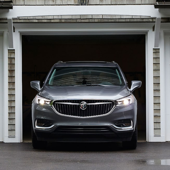 Enclave Premium featuring its winged headlamps and signature front grille.