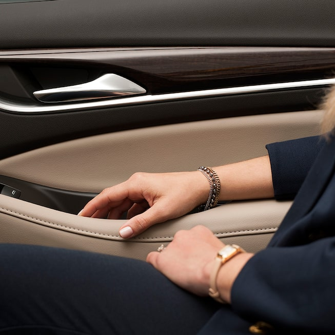 Leather appointed seating, warm wood tones, and brushed chrome accents in the 2019 Enclave.