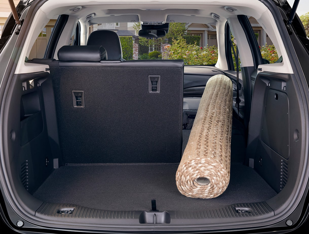 The fold-flat front passenger and second row seats inside the Buick Encore small luxury SUV.