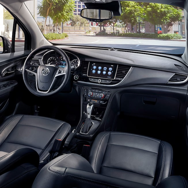 Interior of the 2019 Encore small luxury SUV featuring available heated driver and front passenger seats.