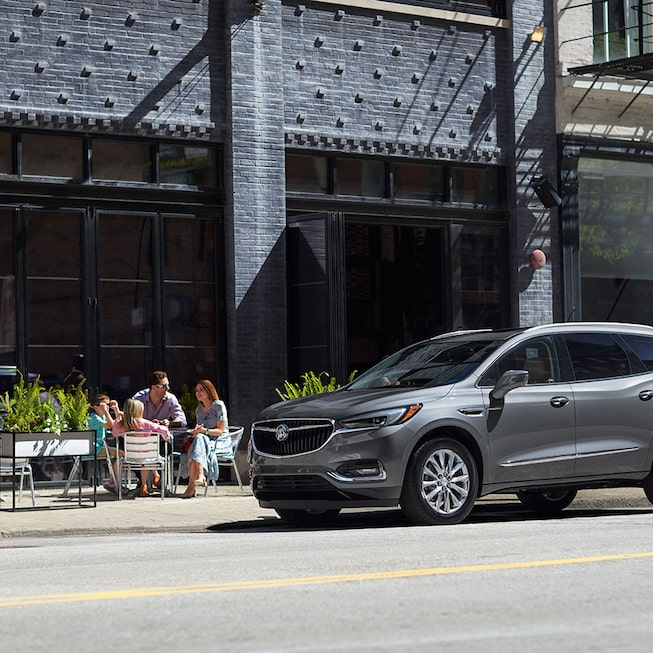 2020 Buick Enclave Mid-Size SUV Exterior Front Side Beside A Building.