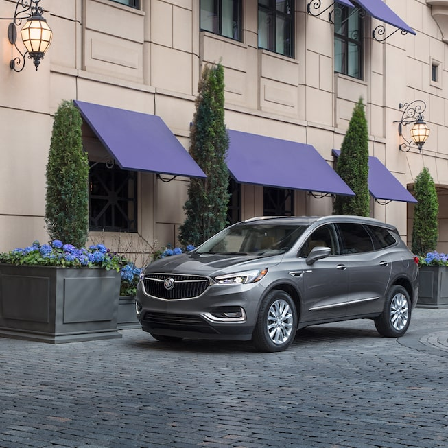 2020 Buick Enclave Mid-Size SUV Exterior Front Side Beside A Shop.