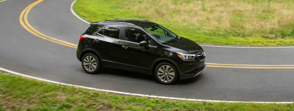 2020 Buick Encore Small SUV Side View Driving Down Street.