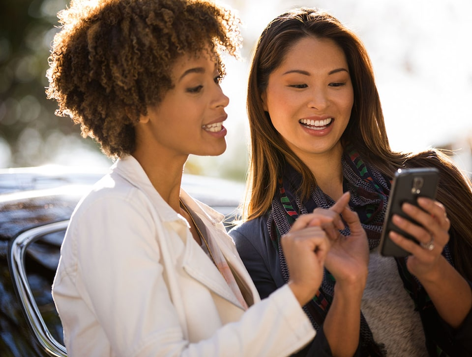 Two women using the 2021 myBuick App.