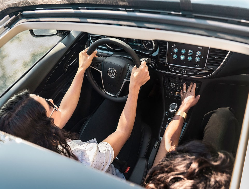 2020 Buick Encore Small SUV Key Feature: Sunroof View Of A Woman Driving In Front Seat.