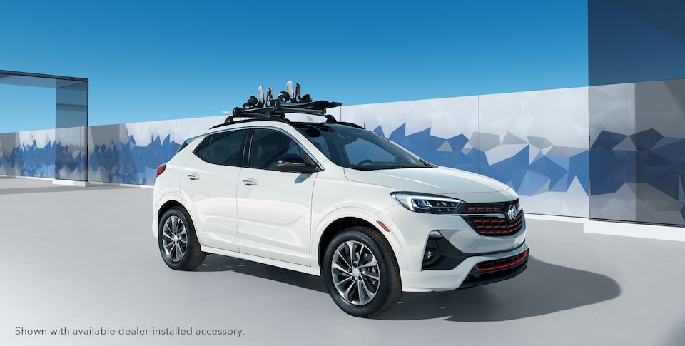 Snowboard attached to the 2020 Buick Encore GX Sport Touring roof rails.