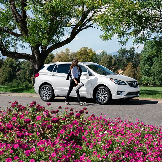 Parked Summit White 2020 Buick Envision.