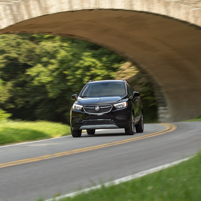 2021 Buick Encore driving on the road.
