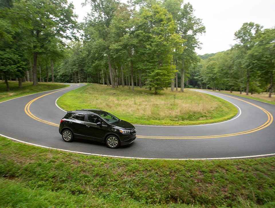 2021 Buick Encore driving on a curved road.