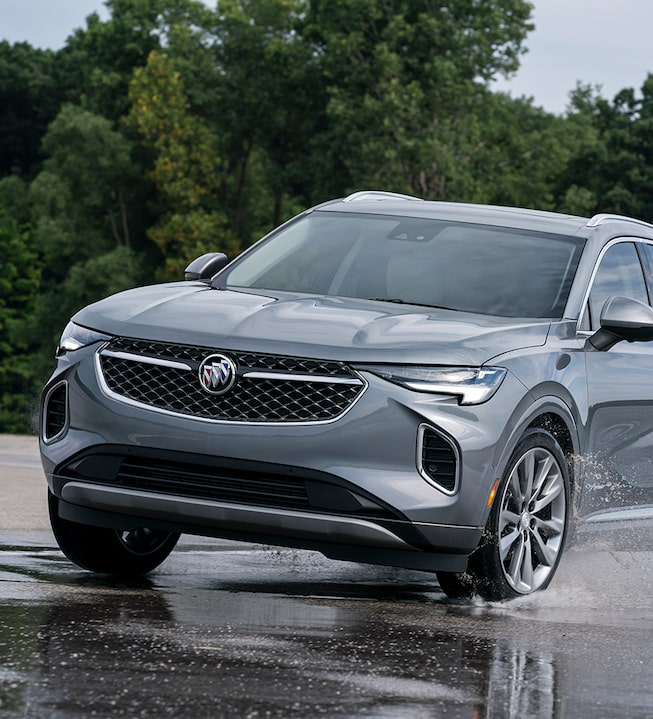 2021 Buick Envision driving on the a puddle of water.