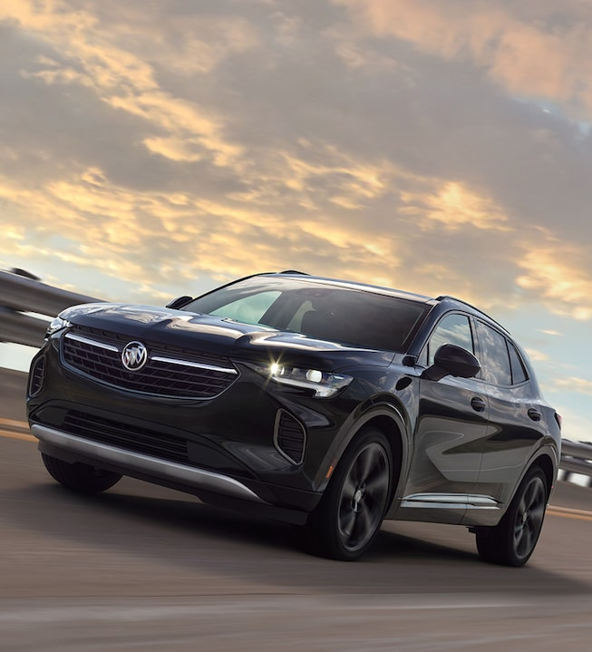 2021 Envision compact SUV driving on the road.