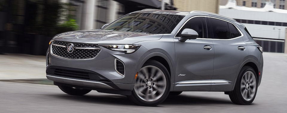 2021 Buick Envision compact SUV driving on the road.