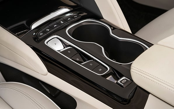 2021 Buick Envision Avenir interior center console and cup holders.