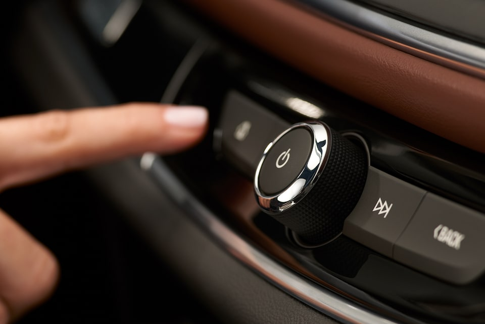 2020 Enclave Avenir Mid-Size SUV Pressing Power Control Button.